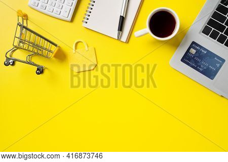 Top View Of Online Shopping Design Concept With Credit Card, Note, Calculator And Computer.