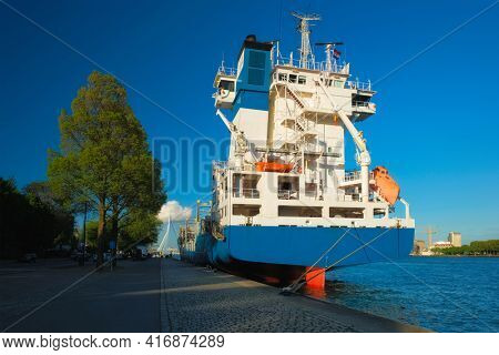 Cargo vessel moored to the quay of Nieuwe Maas river in Rotterdam