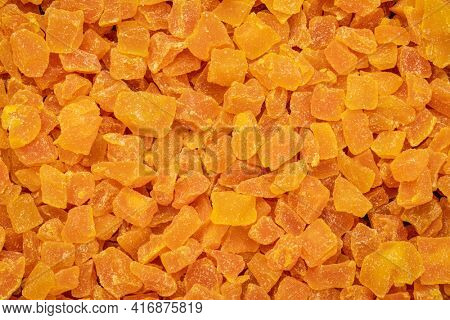 background and texture of dried mango fruit diced
