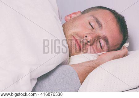 Mature man sleeping at home
