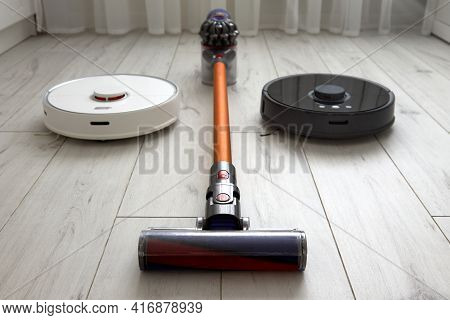 We Find Out Which Of The Vacuum Cleaners Is Better: A Black Robot Vacuum Cleaner, A White Robot Vacu