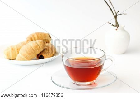 Tea In A Transparent Cup And Homemade Croissants With Jam