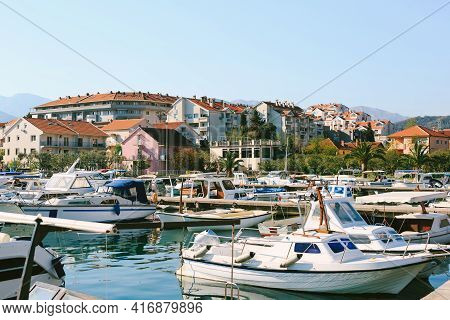 Boat Pier In Tivat, Montenegro. Small Fishing And Pleasure Boats Are Moored In The Marina.