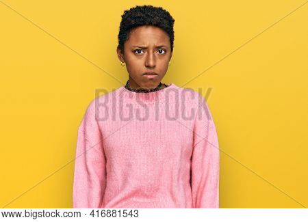 Young african american woman wearing casual clothes skeptic and nervous, frowning upset because of problem. negative person.