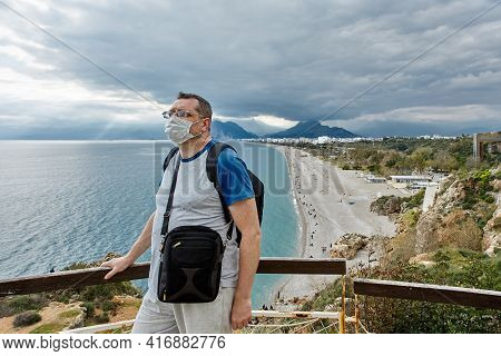 Deserted Beach In Antalya Turkey, European Tourist Is Wearing Protective Face Mask.