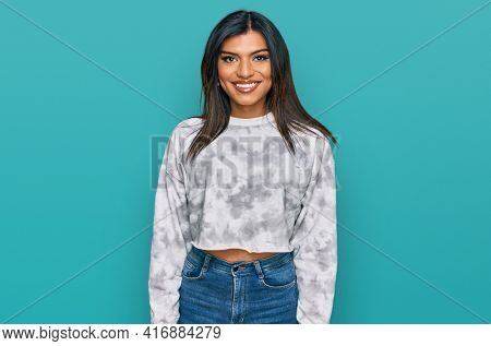 Young latin transsexual transgender woman wearing casual clothes with a happy and cool smile on face. lucky person.