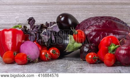 group of dark ripe vegetables on wooden table