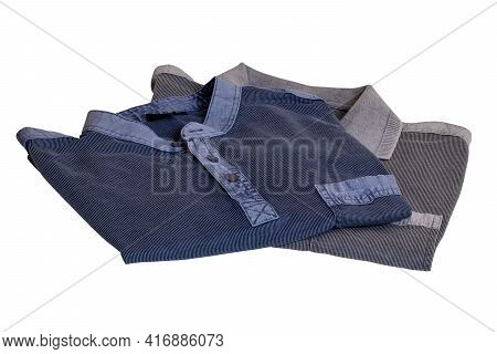 Denim Shirts Isolated. Close-up Of A Stylish Striped Blue Jeans Shirt And A Gray Striped Polo Shirt