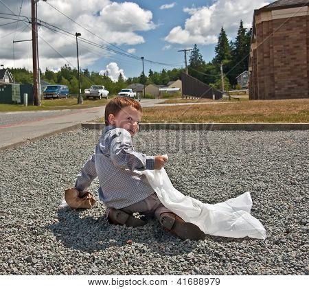 Little Boy Picking Up Garbage