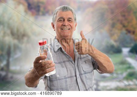 Old Man Wearing Casual Summer Shirt Clothing Holding Water Bottle Smiling Making Thumb-up Like Gestu