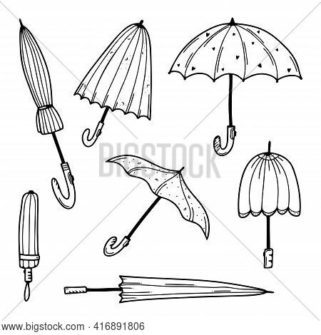 Set Of Hand Drawn Umbrellas Isolated On A White Background. Doodle, Simple Outline Illustration. It