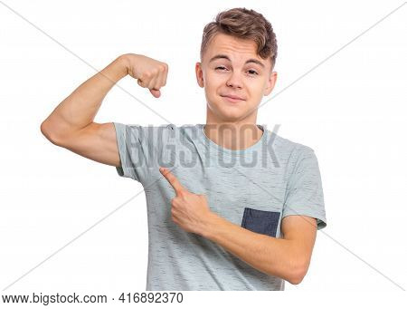 Portrait Of Funny Teen Boy Raised His Hand And Shows Biceps, Isolated On White Background. Handsome