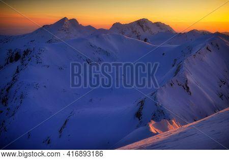 Winter sunset landscape in the Transylvanian Alps - Fagaras Mountains, Romania, Europe