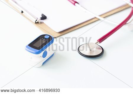 Pulse Oximeter, Finger Digital Device To Measure Person's Oxygen Saturation And A Stethoscope. Reduc