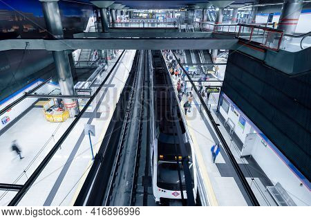 Madrid, Spain - March 4, 2021: Inside Of Of Madrid Subway, Blurred Motion Of Walking People Indoor V