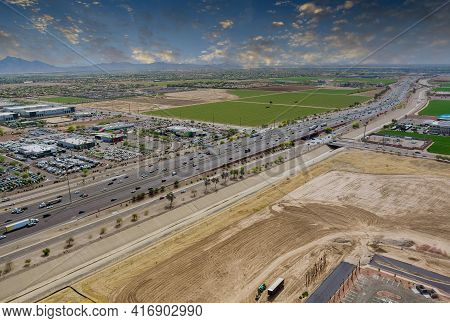 Aerial View Shopping District Center And Parking Lot In Avondale Small Town Panorama View Freeway In