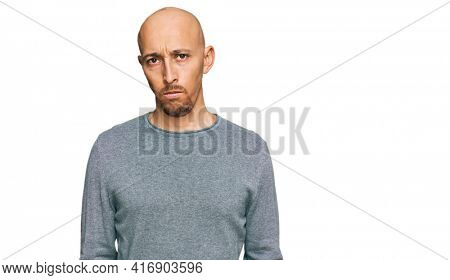 Bald man with beard wearing casual clothes skeptic and nervous, frowning upset because of problem. negative person.