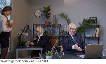 Disappointed Old Business Man Using Laptop Sits At Office Desk Workplace. Senior Confident Male Mana
