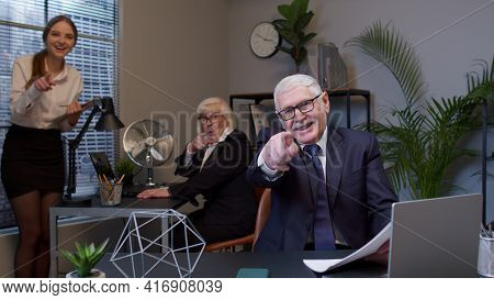 Senior Company Manager Laughing Looking And Pointing At Camera. Mocked And Humiliated With Colleague