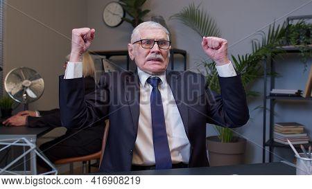 Elderly Man Boss Screaming In Despair After Working In Modern Office Room. Senior Entrepreneur Freel