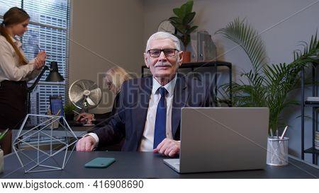 Elderly Man Boss Working In Modern Office Room Interior. Senior Entrepreneur Freelancer Concentrated