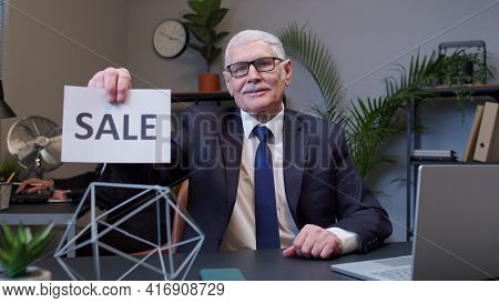 Cheerful Senior Business Company Manager Showing Black Friday Sale Word Advertisement Inscriptions B