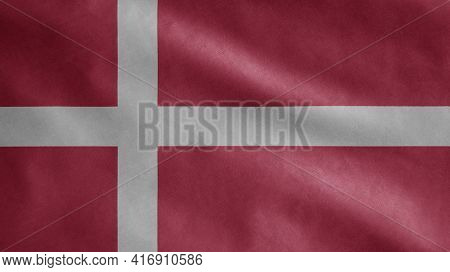 Danish Flag Waving In The Wind. Close Up Of Denmark Banner Blowing Soft Silk.