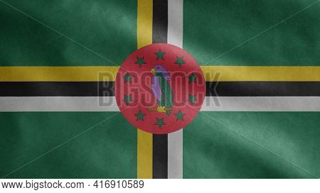 Dominican Flag Waving In The Wind. Close Up Of Dominica Banner Blowing Soft Silk