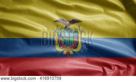 Ecuadorian Flag Waving In The Wind. Close Up Of Ecuador Banner Blowing Soft Silk