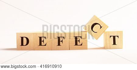 On A Light Background, Wooden Cubes With The Text Defect
