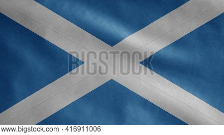 Scottish Flag Waving In The Wind. Close Up Of Scotland Banner Blowing Soft Silk.