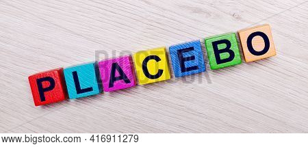 On A Light Wooden Background On Multi-colored Bright Wooden Cubes The Word Placebo