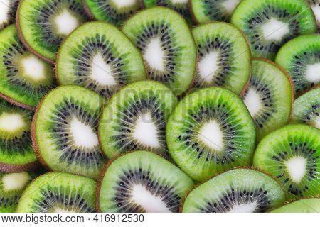 Sliced Kiwi Background. Ripe And Fresh Fruit Pieces. Close-up Of Kiwi Slices.