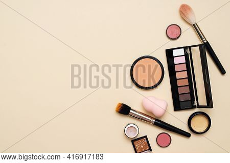 Face Powder, Brush And Various Cosmetic Decorative Makeup Products On A Color Background. Close Up.