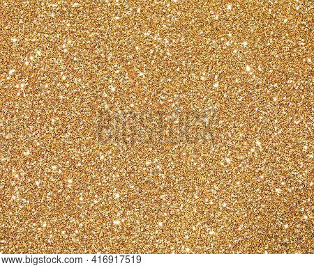 Glitter Golden Background With Glitter And Glare Of Lights