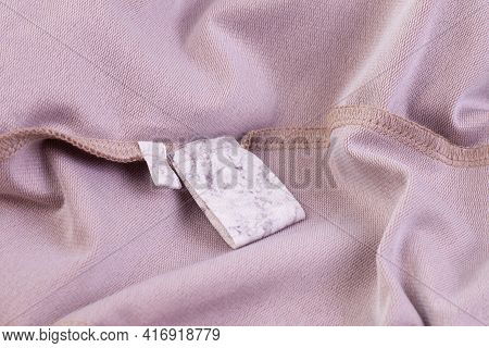 Macro Folds Of Fabric Mock Up Fabric Blank White Tag For Clothing Care Instructions And Tag With Siz