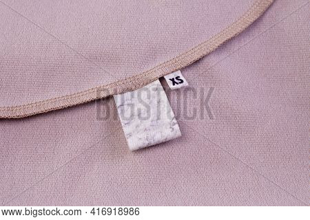 Macro Mock Fabric Blank White Tag For Clothing Care Instructions And Tag With Size Xs Sewn Into The
