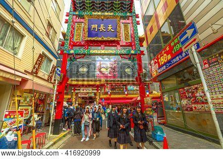 Yokohama, Japan - April 21, 2017: People And Asian Girls In School Uniform Walking Near The Gate In