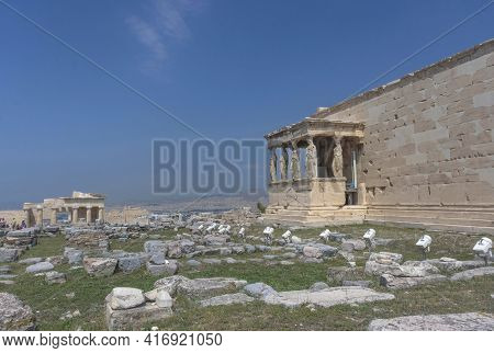 The Ancient Erechtheion Temple With Beautiful Caryatids On Acropolis Hill, Famous Tourist Attraction