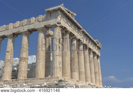 The Ancient Parthenon Temple On Acropolis Hill, Famous Landmark And Tourist Attraction In Athens, Gr