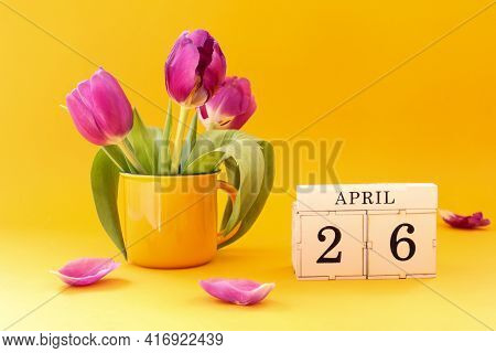 Calendar For April 26: Cubes With The Number 26 , The Name Of The Month Of April In English, A Bouqu
