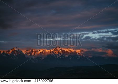 Scenic Mountain Landscape With Great Snowy Mountain Range Lit By Dawn Sun Among Low Clouds. Awesome