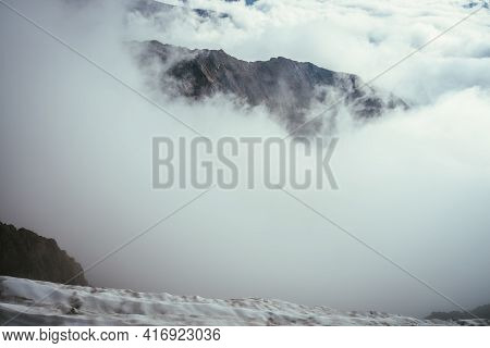 Wonderful Mountain Scenery With Great Rocks In Dense Low Clouds. Atmospheric Mountain Landscape With