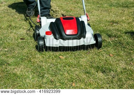 Aeration With A Scarifier. Using A Scarifier In The Garden To Improving Quality Of The Lawn In Sprin