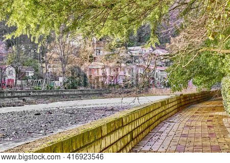 Embankment Of Mountain Khosta River. Winter Cityscape. Khosta, A Resort On Black Sea Coast Of Caucas