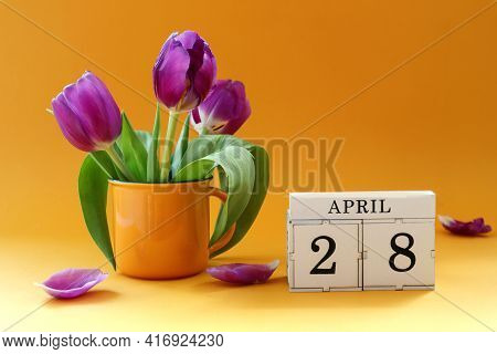 Calendar For April 28: Cubes With The Number 28 , The Name Of The Month Of April In English, A Bouqu