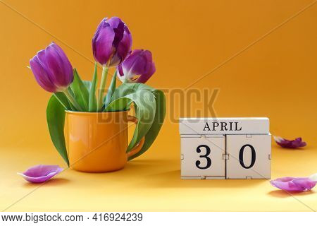 Calendar For April 30: Cubes With The Number 30 , The Name Of The Month Of April In English, A Bouqu