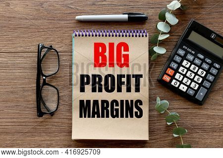 Big Profit Margins. .text On Craft Paper On Wood Background Near Calculator.