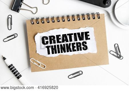 Creative Thinkers. Text On White Notepad Paper On Light Background