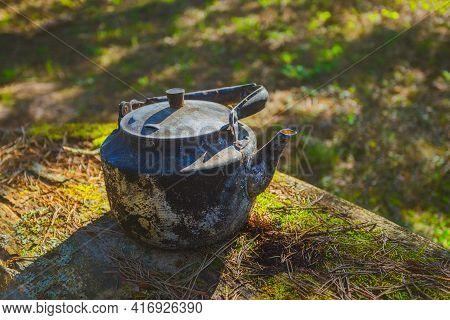 Vintage Large Aluminum Tea Pot Kettle Stove On Nature Background. Old Tea Pot